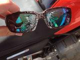 Schützende Brille